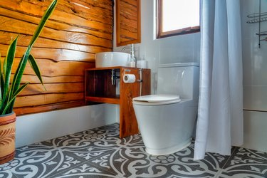Old meets new modern bathroom with wood paneling wall