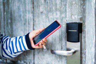 open door with smart phone