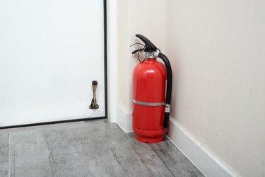 Fire extinguishers in home door.