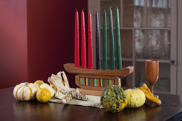 Kwanzaa decorations, alter with Kinara, corn, gourds, chalis