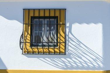 barred window in Evora, Portugal