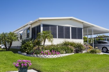 Mobile Home with Flowers and Tropical Foliage