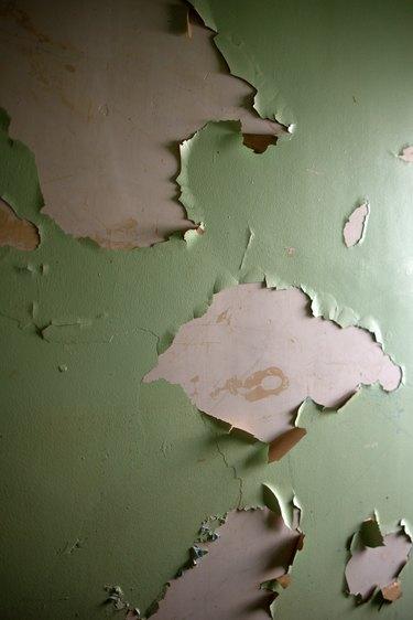 Lead based paint peeling on an old wall.