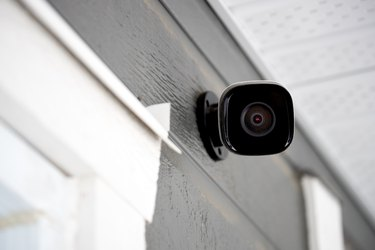 Black cctv outside building, home security system