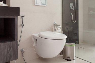 White toilet bowl in the modern bathroom.