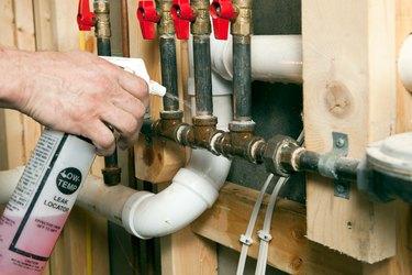 Plumber Using Leak Locator Spray on Gas Lines