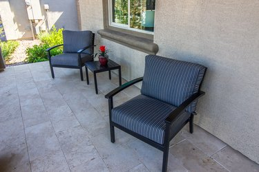 Front Patio With Small Table & Two Arm Chairs With Striped Cushions