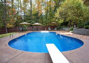 Inground residential swimming pool in Autumn
