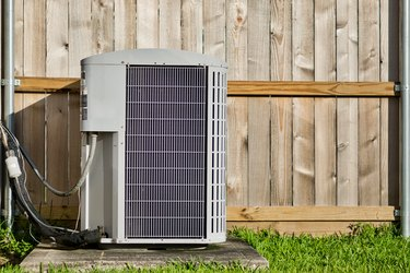 Central air conditioning unit in a residential backyard.