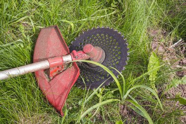 trimmer for cutting grass after work lying on the ground