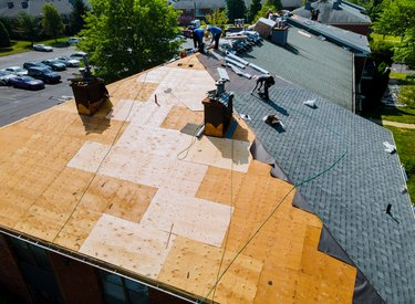 Roof repairs old roof replacement with new shingles of an apartment