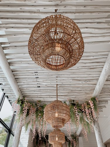 Vintage Boho Beach Style Rattan Lamps Hanging in a Tropical Indoor Setting in West Palm Beach, Florida