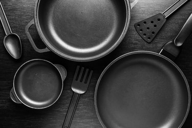 Black cookware with a nonstick coating on black background