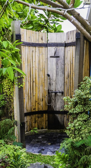 Outdoor shower in nature Bamboo wood surrounded.