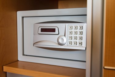 Electronic safe on shelf in cabinet