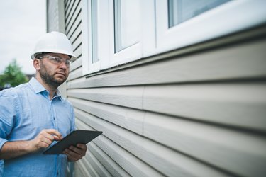 Professional building inspector at work on residential building