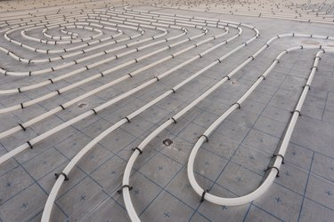 Underfloor heating system installation. Close up on water floor heating system interior of a new indoor swimming pool and SPA center. Plumbing pipes. Individual Heating.