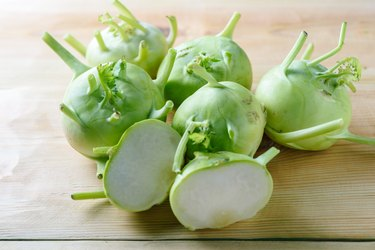Fresh green kohlrabi or german turnip or turnip cabbage on wood background.