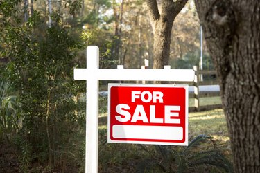 Home for sale with real estate sign.  Front Yard.