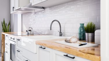 Scandinavian open style kitchen in white color, white tiles