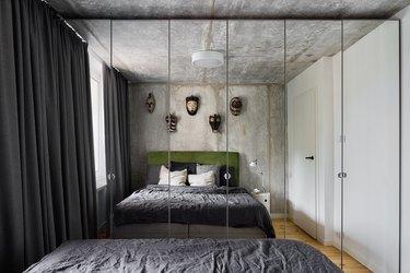 Modern designed bedroom with mirror wardrobe