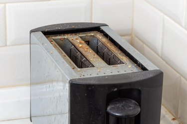 Dirty toaster with burnt crumbs
