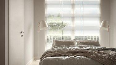 Bedroom in beige tones,  floor lamps, large window with blinds, modern interior design