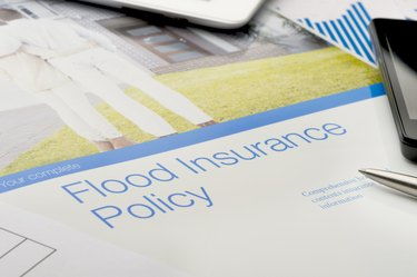 Flood insurance policy brochure with image of a couple