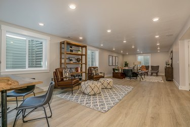 Wood flooring in basement rec room area with a lot of space