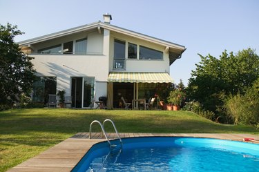 Swimming pool in front of two storey house