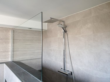 Modern rain shower with glass wall in the bathroom
