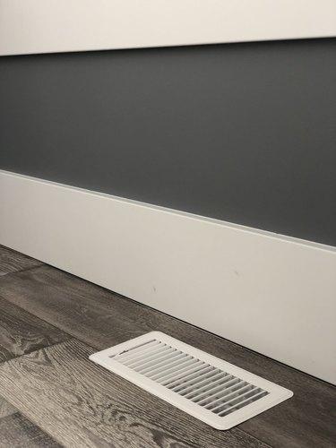 Floor vent next to floor boards