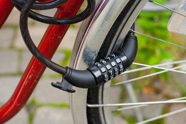 Black bike lock with combination number lock