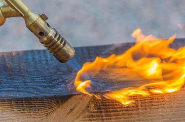 fire from a gas burner treated lumber