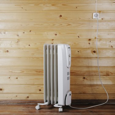 Heater against a wooden wall. Space for text or design