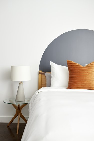 gray arch accent wall behind bed