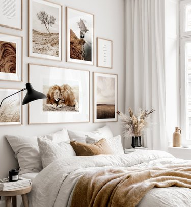 bedroom accent wall filled with artwork