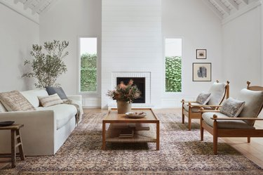 living room with seating and vintage-like rug