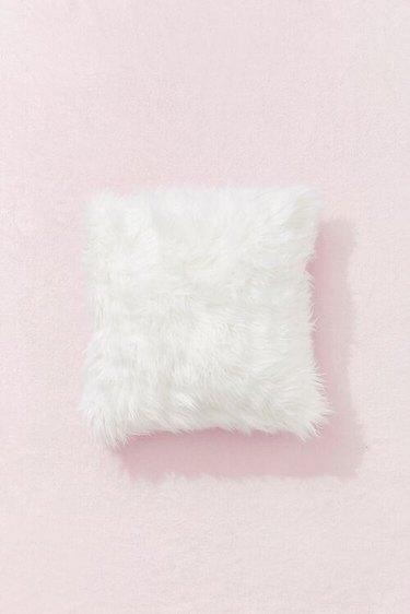 white faux fur throw pillow