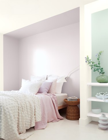 bedroom with white, light purple, and light green paint