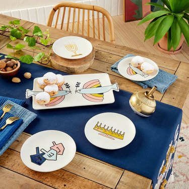 overhead view of wood table with Hanukkah decorations