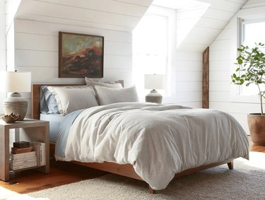 Bedroom with painting and neutral furniture