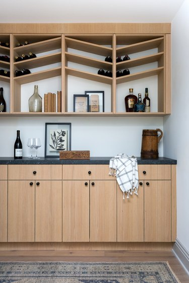 wine room with wood cabinets and storage