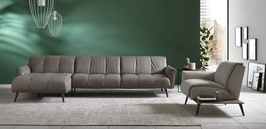 A gray Natuzzi couch in a living room