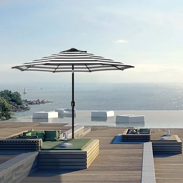 Striped umbrella by pool
