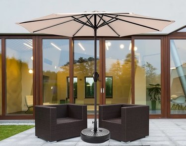 Tan umbrella with chairs