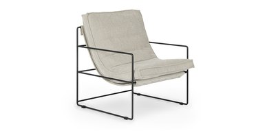 off-white lounge chair with black frame