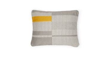 pillow in gray pattern with yellow area