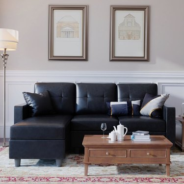 Winston Porter Sylvette 78.5-Inch Wide Faux Leather Reversible Sofa and Chaise With Ottoman