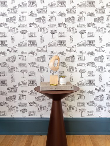 black and white wallpaper near side table with decor